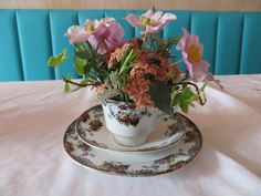 Vintage tea- cup arrangement of japanese anemone, ivy, rosemary by Apple Blossom Flowers & Wedding Hire