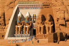 The Great Temple at Abu Simbel, which took about 20 years to build, was completed around year 24 of the reign of Ramesses the Great (1265 BC). It was dedicated to the gods Amun, Ra-Horakhty, and Ptah, as well as to the deified Rameses himself. Four colossal 20 meter statues of the pharaoh with the double Atef crown of Upper and Lower Egypt decorate the facade of the temple, which is 35 meters wide and is topped by a frieze with 22 baboons, worshippers of the sun and flank the entrance.