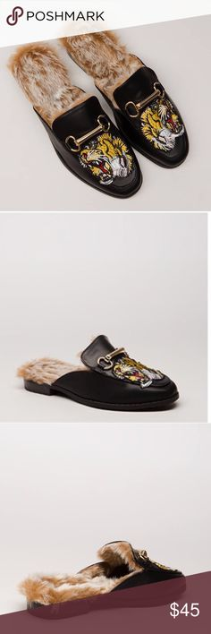 """Tiger patch fur lined Mule Tiger patch fur lined Mule  Slip-on vegan leather mule flats feature a notched tongue with a bracketed bar charm, a footbed lined with shaggy faux fur, and a slightly squared toe box with an embroidered patch of a roaring lion. Shoes are finished with a ridged sole, a slim stacked heel, and no closures.Heel height: 1"""" Shoes Mules & Clogs"""