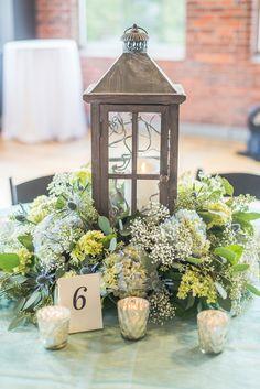 hydrangea centerpiece - photo by Emily Platt Photography http://ruffledblog.com/high-tide-inspired-wedding-in-greenville