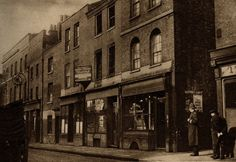 Grime and gloom in St George's St photographed by William Whiffin. St George's St used to be the famous Ratcliff Highway and runs from East Smithfield to Shadwell High St. It is a maritime street and contains various establishments, religious and otherwise, which cater for the sailoR