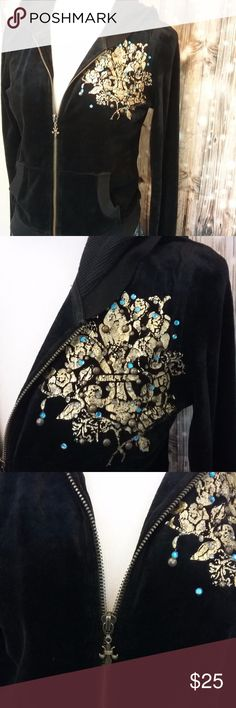 Miss Me Black Velvet Zip Hoodie Front left breast has a fleur de lis in cracked gold paint. The back has a saying and both have grommets and bling. I do not know what it says in the back. I have a picture of the whole word, maybe you can figure it out. The zipper has a decorative fleur de lis on it. Size Medium Length 21 Width 36 Sleeve 25  65% cotton  35% polyester Inv #B43 Miss Me Tops Sweatshirts & Hoodies