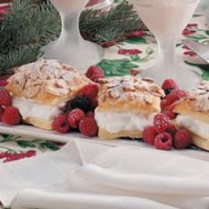 Almond Puff Pastries Recipe Desserts with puff pastry, eggs, water, sliced almonds, sugar, whipping cream, confectioners sugar