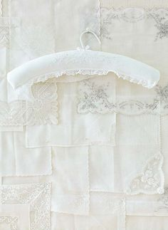 New use for gorgeous old handkerchiefs - padded clothes hangers!