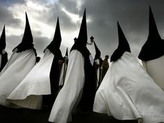 Nazarenos (hooded penitents) of La Esperanza De Triana (Our Lady of Hope of Triana) Brotherhood during Semana Santa (Holy Week) in Seville, Spain. (Associated Press)