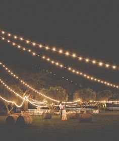 Hay bales and string lights -- dreamy.