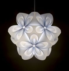 """A lampshade composed of 20 die-cut identical elements in which users can easily assemble, without any tools or glue, by simply folding ready-cut/scored sheets. Designed with the """"single material for single product"""" concept, which aims to facilitate the recycling process, unlike other products which contain different parts and materials."""