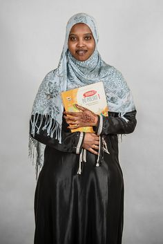 """Alsi from Somalia. Her portrait was featured in the outdoor photo exhibition by Jacek Herok entitled """"INNI-OBCY-SWOI"""" aiming to show residents and visitors of Warsaw that refugees make an integral part of the Polish society. © J. Herok/2012"""