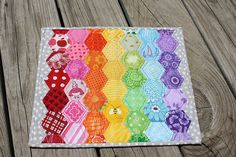 Great color combo way to use hexagons.  A mug mat, hot pad or a placemat.