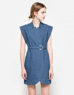 From C/MEO COLLECTIVE, a mid-weight dress in Denim. Featuring a stand up collar, pinstripe detail, concealed snap closures, waist tie belt with d-ring closure, full lining, cap sleeves and a relaxed fit.   • Dress in Denim • Stand up collar • Pinstrip