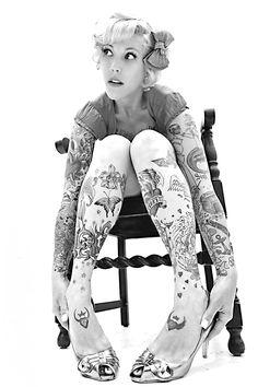 I like the photo mainly, but she's got a few nice tattoos as well.