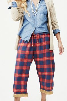 Made proudly in India by women working to remain free from sex slavery. Perfect for meaningful holiday gifts or a little something for yourself.  Classic flannel plaid pajamas never looked cozier: red, navy and traces of green and yellow intersect in the perfect plaid. Trimmed with a Banarasi border of shimmery gold.