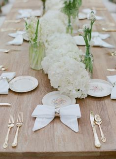For Zoe and Bobby's wedding brunch, guests sat at rustic wooden tables featuring an ivory hydrangea runner. White linen napkins were fastened with silver rings to make elegant bow shapes. Brunch Wedding, Chic Wedding, Wedding Decor, Wedding Cake Table Decorations, Wedding Tables, Rustic Wooden Table, Wooden Tables, Table Setting Inspiration, Silk Arrangements