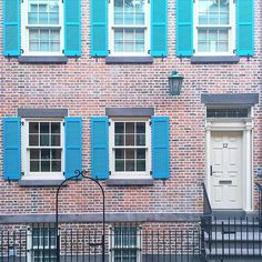 A colorful commute through the West Village in New York City this brick house with bright blue shutters is a great idea to add color to your home