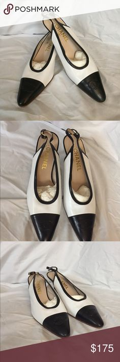 Chanel Black and white mule with back strap. Black and white pre-owned Chanel shoes. Great condition. Priced to sell! CHANEL Shoes Mules & Clogs
