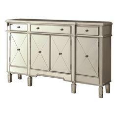 """Die Kommode aus der Serie """"Classic Solitaire"""" bereichert Ihr Einrichtungskonzept. Das Möbel im rustikalen Landhaus-Stil strahlt durch die verspielten Fronten eine tolle Behaglichkeit aus. Die antiken Verzierungen verleihen dem Schränkchen eine tolle Optik. Hinter 4 Türen und in 3 Schubladen bewahren Sie alles auf, was Ihnen wertvoll ist. Die hochwertige Verarbeitung aus teilmassivem Holz steht für eine robuste Qualität, an der Sie lange viel Freude haben werden."""