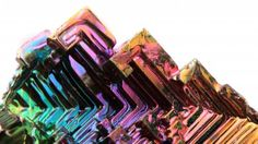 Glittering iridescently, bismuth crystals are hypnotically stunning and you can make your own at home! YouTube user NightHawkInLight shows you how to make