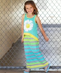 It's hard to go wrong with a comfy, colorful dress, especially when it sports vibrant stripes on an equally trendy maxi silhouette. A bloom-emblazoned overlay gives this statement-maker extra style points and fun-to-wear fashion flair.
