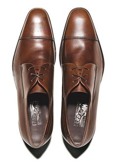 Short Man, Slim Shoe.  You don't want to look like you've got weights around your ankles. Wear slender shoes.