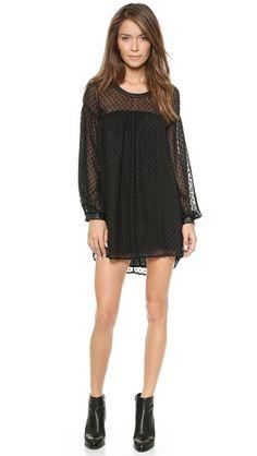 flirty little black dress with sheer polka dot sleeves