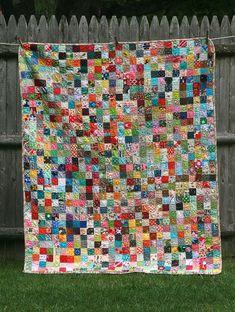 scrappy postage stamp quilt by Applecyder