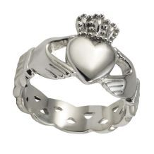 Always wanted one of these... The Claddagh ring was fashioned of three symbols; the hands signifying Friendship, holding a heart signifying love, topped with a crown for loyalty.  When wearing the ring the heart pointed toward you means your heart is taken: the heart pointed away from you means your heart is free.