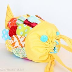 Create your own little Fabric Fishy Purse with a drawstring closure.  (Free pattern pieces included.)