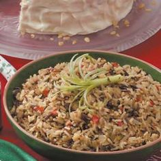 """Holiday Wild Rice Recipe -Wild rice mix gets a boost of seasonal color from red pepper and green onions in this side dish from Diane Dalovisio of Lake Charles, Louisiana. """"It's my husband's favorites,"""" she writes."""