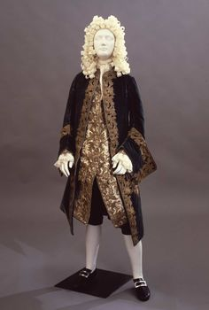 1720, Italy - Men's suit in two pieces, jacket and habit à la française. Jacket in light blue silk with metal buttons covered upholstered with gold thread. Habit à la française in white satin