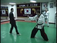 Master Shin schools a black belt on the applications and efficiency of Hapkido. all while wearing a pretty fresh suit.