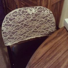 Just a cap for a folding chair -- Chair Covers for Folding Chairs- maybe find a cute fabric!
