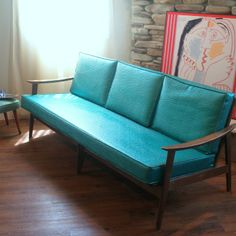 VINTAGE DANISH MODERN Sofa Lovely 1950's Mid Century Modern Furniture Lounge Style Solid Wood Teal and Walnut European Made Chicago Listing. $990,00, via Etsy.