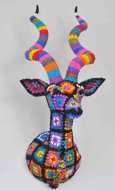 Plarn crochet (Plastic Yarn). South African designer Magda van der Vloed, this spectacular trophee is made out of hand-crocheted plastic bags.