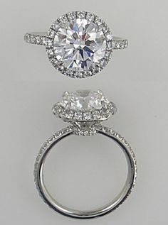 Round halo with diamond pave band. How pretty! I like that the diamonds around the main diamond are small