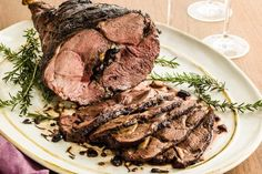 Roast Leg of Lamb with Rosemary and Garlic - just make a paste with garlic, olive oil and rosemary, smear it all over the leg of lamb, and roast it! Easy.