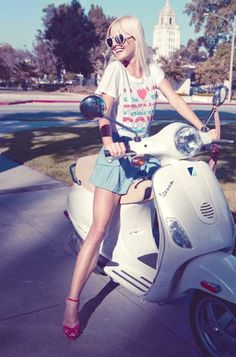 Girl on a White Vespa wearing a I Love French Boys T-Shirt.