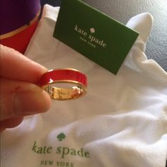 """NWOT Kate Spade """"Live Colorfully"""" Red Ring NWOT Kate Spade Red Ring, with protector bag and box. Perfect for gift giving! (Selling matching red bangle bracelet in a separate listing.) kate spade Jewelry Rings"""