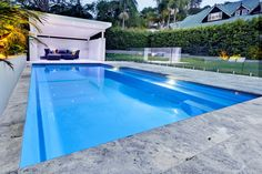 The Symphony pool is a stylish, contemporary fibreglass swimming pool. Visit Narellan Pools to get a free quote from a qualified swimming pool builder. Pool Paving, Concrete Pool, Backyard Pool Landscaping, Pool Gazebo, Backyard Pergola, Landscaping Tips, Pool Cost, Pool Colors, Pool Landscape Design