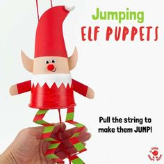 This Jumping Paper Cup Elf Puppet Craft is so much fun. Pull the string to watch the elves leap up and down! Such a cute interactive Christmas craft for kids. #elves #elf #christmas #christmascrafts #christmascraftsforkids #elfcrafts #papercupcrafts #christmasornaments #christmastoys #toys #kidscraftroom #elfontheshelf