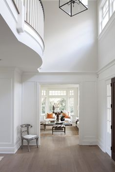 Two Story Foyer - Design photos, ideas and inspiration. Amazing gallery of interior design and decorating ideas of Two Story Foyer in entrances/foyers by elite interior designers. White Rooms, White Walls, White Hallway, Custom Home Builders, Custom Homes, Foyer Design, House Design, Interior Trim, Interior Design