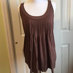 Brown sleeveless shirt In great condition. Can go under a great blazer. MICHAEL Michael Kors Tops Tees - Short Sleeve