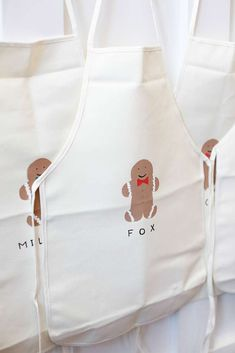 Gingerbread aprons at a woodland Christmas birthday party! See more party planning ideas at CatchMyParty.com!