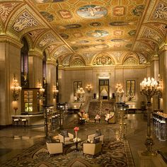The historic Palmer House Hilton in Chicago, Illinois. Rebuilt in 1875 after being destroyed in the 1871 Great Chicago Fire, this luxury hotel features one of the most breathtaking lobbies in the world. Visitors to Chicago drop in to marvel at its stunning architecture, gorgeous sconces and frescoed ceiling design.