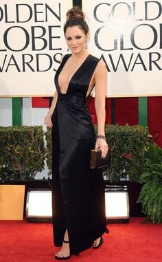 """Katharine McPhee from Best Dressed at the 2013 Golden Globe Awards  The Smash star turned heads in an incredible gown by Theyskens' Theory. The talented star stole the show in a daring satin number featuring a plunging neckline and thigh-high slit, and accessorized with an Oroton clutch. """"I wanted to do something sexy this year. Last year I was flirty and sweet,"""" she told us."""
