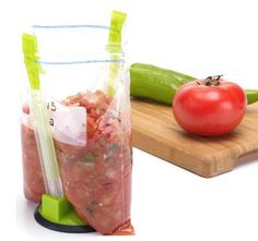 Bag holder - it really is a great buy and will free your hands to make sure your food goes IN the bag!