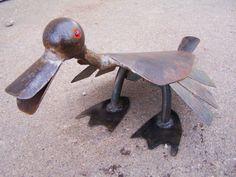 Flat billed bird garden art sculpture