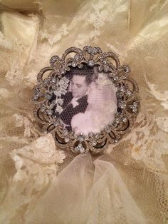 I wanted to give my niece a keepsake gift using my mother's 60 year old wedding dress. I didn't have time to make anything using the silk. So I took a piece of the lace and placed it over a picture of my parents on their wedding day. I purchased a small frame from A.C. Moore and now my niece has a piece of her grandparent's special day to remember wonderful parents to7 and grandparents to 14!!