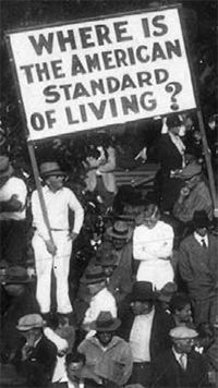 Where Are Today's Mass Movements? What we can learn from the millions who demonstrated for jobs, government relief, and collective bargaining rights in the 1930s.  Protest sign: Where Is the American Standard of Living?