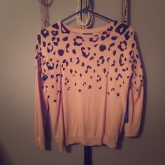 Forever 21 leopard sweater.  Gorgeous!!! Forever 21 size large sweater. Leopard print on a nude fabric. Perfect piece for work or a night on the town. It has never been worn. No flaws. Forever 21 Sweaters Crew & Scoop Necks