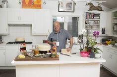 Inside Andrew Zimmern's Kitchen Chinese Chicken Wings, Delicious Destinations, Andrew Zimmern, Kitchen Upgrades, Kitchen Ideas, Under Cabinet Lighting, Food Network Recipes, Countertops, Wall Street